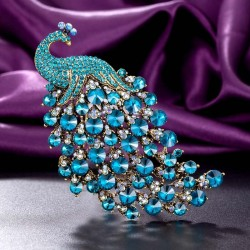 Luxurious brooch with large crystal peacock