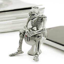 Skeleton sitting on toilet - rubber keychain